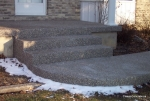 Exposed aggregate front door steps.